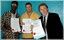 James Arku, Michael Lindstrom and Len Lindstrom with first Liberty licenses June 2004